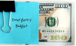 $100 bill with note that says Emergency Budget